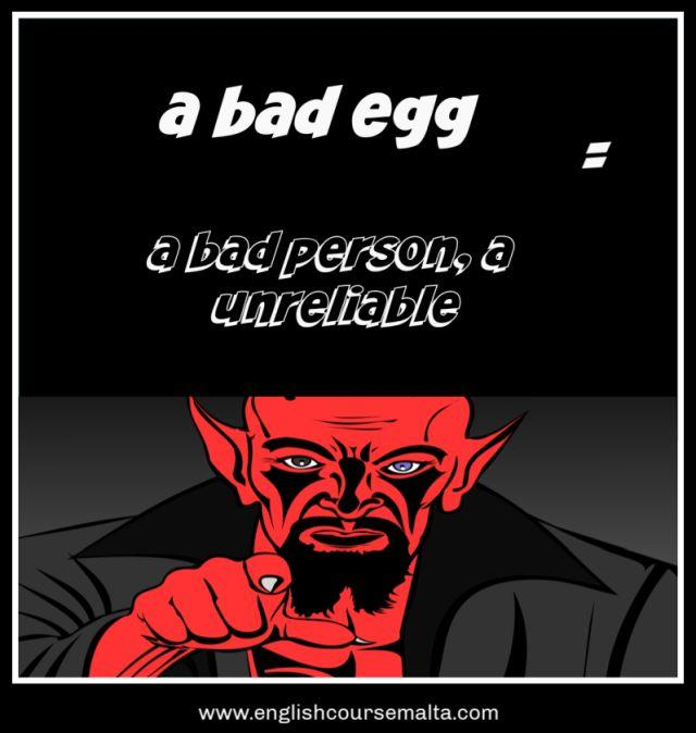 A picture infographic of the idiom a bad or rottten egg. This idiom means that a person is bad, unreliable or a bad influence. The picture shows a red demon in a black jacket pointing a finger with sharp nails.