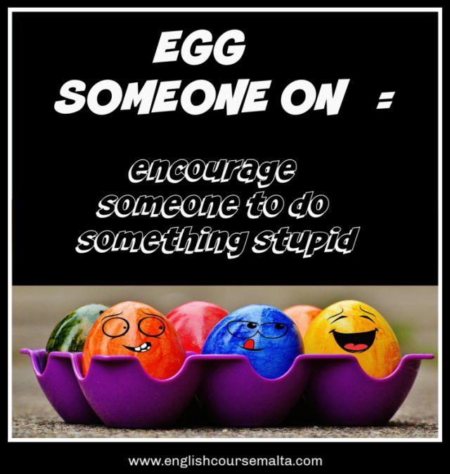 A picture infographic with the text to egg someone one. This idiom means to encourage or dare someone to do something which is generally stupid.